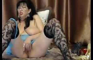 Busty full-grown masturbates with dildo on cam