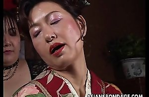Asian mature bitch has a rope session..