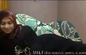 Arab MILF wearing hijab masturbating abyss down..