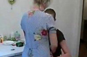 Grandson bonks his old granny in the kitchen