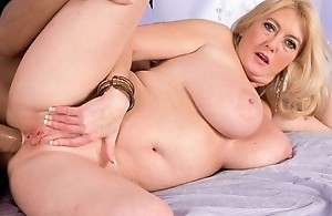 The super-busty MILF receives ass-fucked