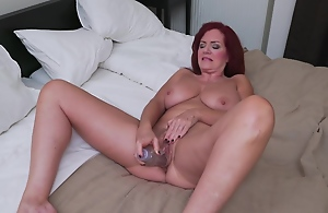 Horny, mature redhead with big..