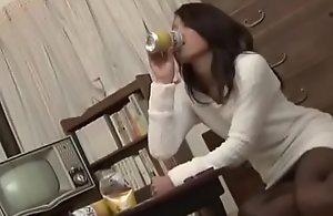 Sexy Japanese mom is fingering herself..