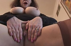 Busty mature concerning flimsy pussy in mini..
